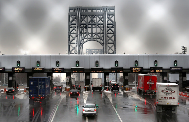 Vehicles slow for tolls before crossing the George Washington Bridge on December 17, 2013 in Ft. Lee, New Jersey.