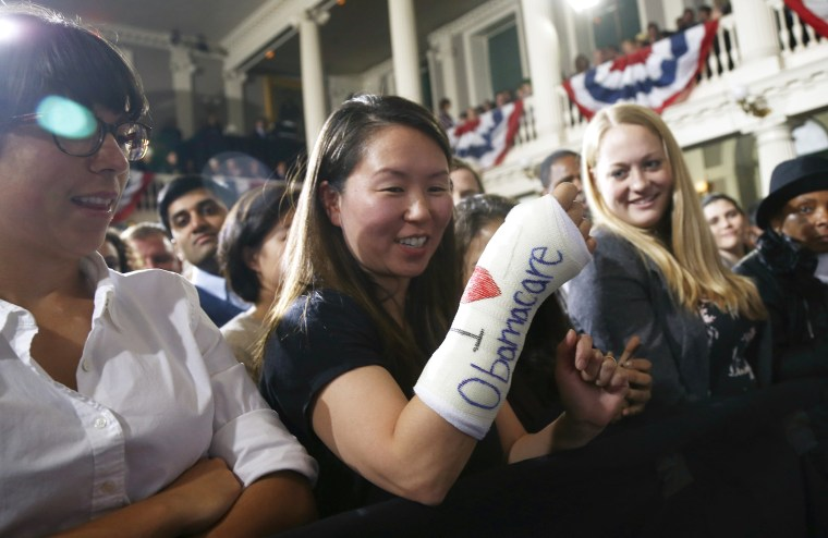 "Cathey Park, from Cambridge, Mass., shows the words ""I Love Obamacare"" on her cast for her broken wrist as she waits for President Barack Obama to speak about the federal health care law, Oct. 30, 2013 in Boston."