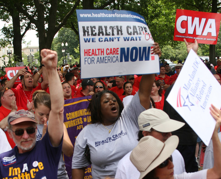 People march during a rally for affordable health care June 25, 2009 on Capitol Hill in Washington, D.C.