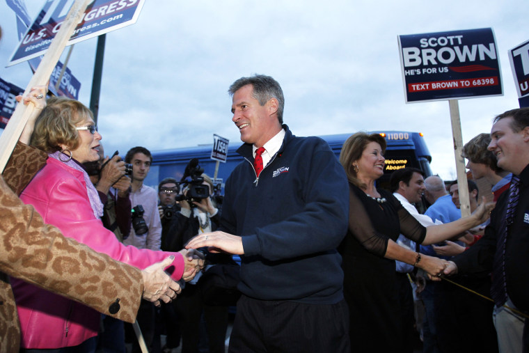 Senator Scott Brown shakes hands with supporters in Wakefield, Massachusetts Nov. 1, 2012.