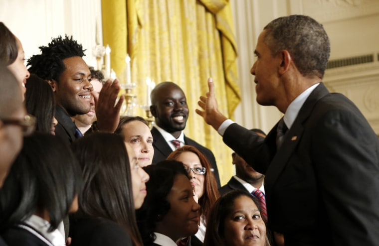 President Barack Obama shakes hands with Roger Brown, of Harlem, NY, during an event at the White House in Washington Jan. 9, 2014