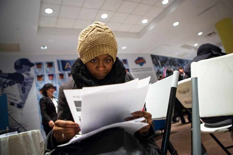 A woman fills out paperwork at a job training and resource fair at Coney Island in New York December 11, 2013.