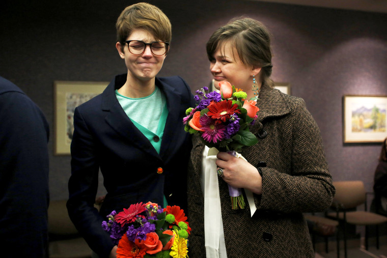 Natalie Dicou and her partner Nicole Christensen wait to get married at the Salt Lake County Clerks office, Dec. 20, 2013.