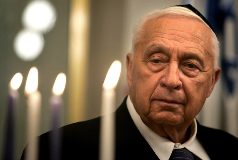 Israeli Prime Minister Ariel Sharon is seen as he takes part in the lighting of a Hanukkah candle at his Jerusalem office, Dec. 27, 2005.