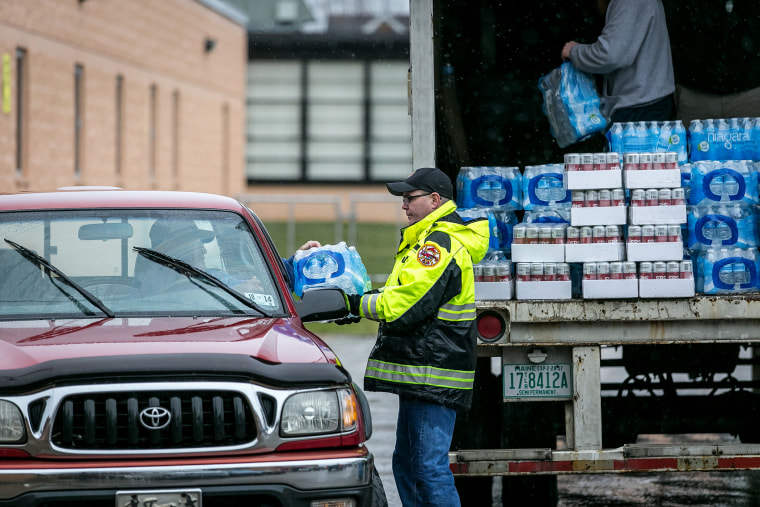 Members of the Nitro Volunteer Fire Department distribute water to local residents following the chemical spill, Jan. 10, 2014 in Charleston, W.V.