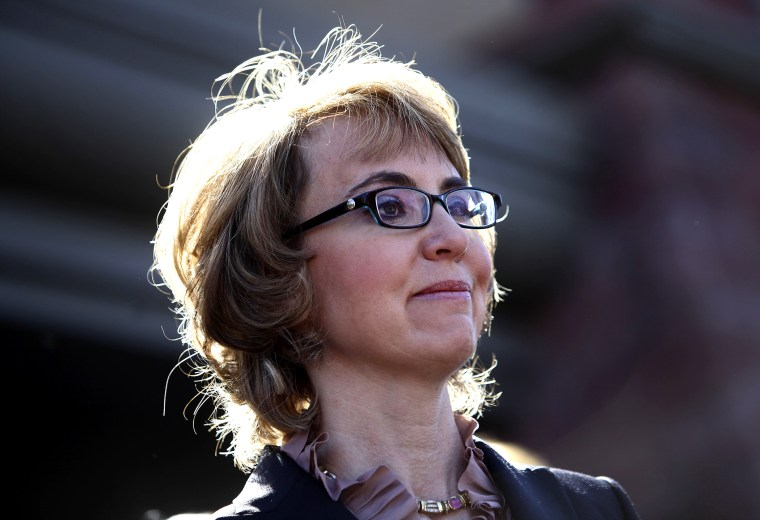 Former Rep. Gabby Giffords attends a news conference outside Safeway grocery store where they asked Congress to provide stricter gun control in the United States, March 6, 2013 in Tucson, Ariz.