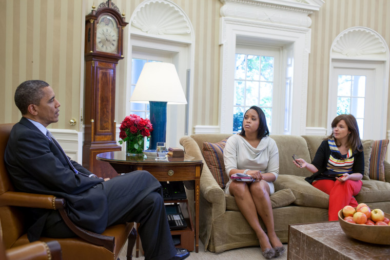 Obama meets with Danielle Crutchfield and Alyssa Mastromonaco in the Oval Office, April 20, 2012.