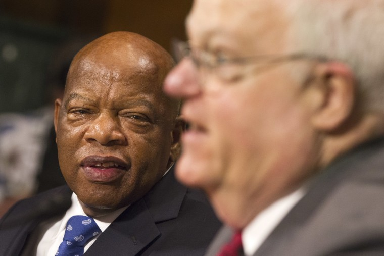 Rep. John Lewis, D-Ga., left, turns to thank Rep. James Sensenbrenner, R-Wis., as he finishes his testimony in support of the Voting Rights Act on Capitol Hill in Washington, July 17, 2013.