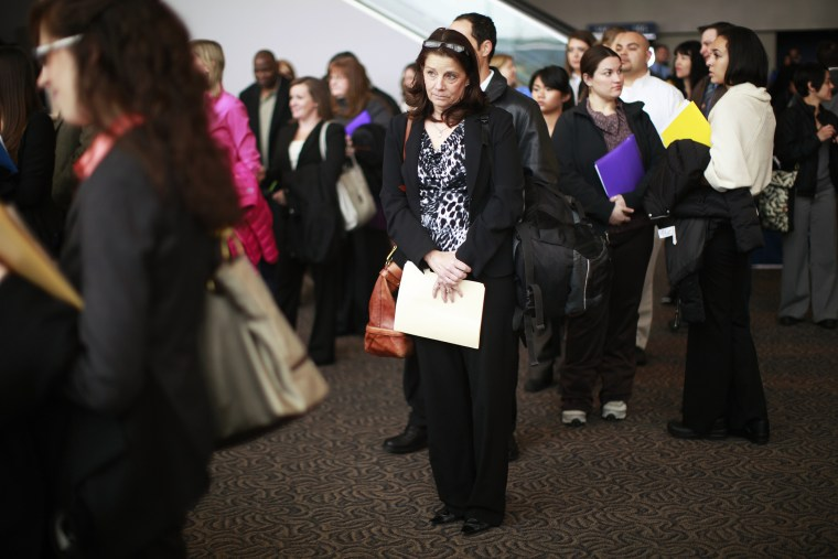 Job seekers listen to a presentation at the Colorado Hospital Association health care career fair in Denver April 9, 2013.