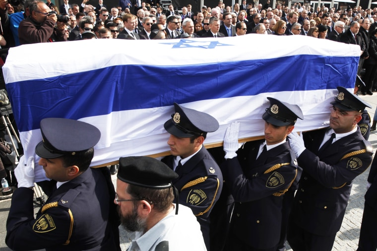 An honor guard carries the coffin of former Israeli prime minister Ariel Sharon, Jan. 13, 2014.
