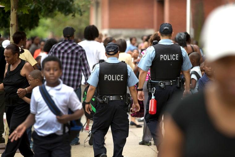 Chicago Police And Neighborhood Officials Escort Children To School