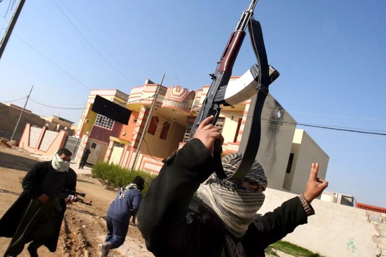 Gunmen patrol in Fallujah Iraq, Thursday, Jan. 9, 2014.