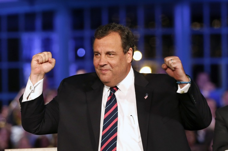 Republican New Jersey Governor Chris Christie gestures as he takes the stage at his election night party in Asbury Park, New Jersey, November 5, 2013.
