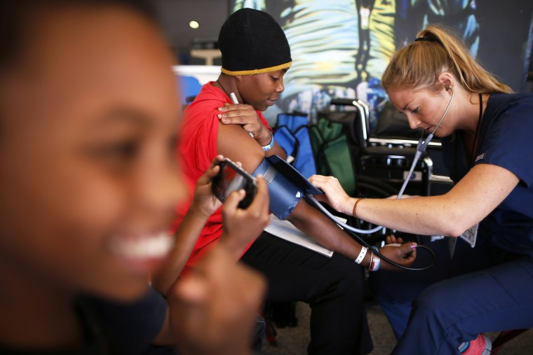 Patricia Broaster has her blood pressure measured at Care Harbor LA, a free medical clinic in Los Angeles, Oct. 31, 2013.