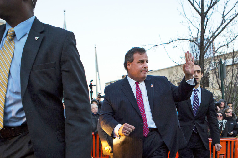 New Jersey Governor Chris Christie leaves city hall in Fort Lee, Jan. 9, 2014.