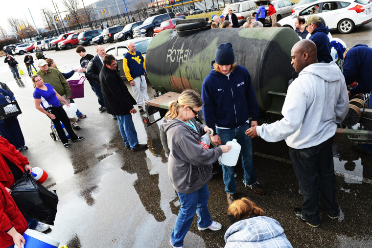 West Virginia American Water customers line up for water at the Gestamp Plant in South Charleston, West Virginia, Jan. 10, 2014.