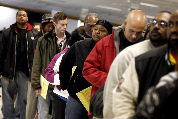 Voters wait in line to cast their ballots at the Franklin County in-person absentee voting location in Columbus