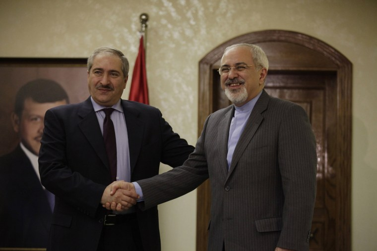 Jordanian Foreign Minister Nasser Judeh (L) shakes hands with his Iranian counterpart Mohammad Javad Zarif (R) during a press conference on January 14, 2014 in Amman.