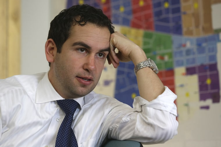 In this Friday, March 15, 2013 photo, Steven Fulop talks to The Associated Press at his campaign headquarters in Jersey City, N.J.