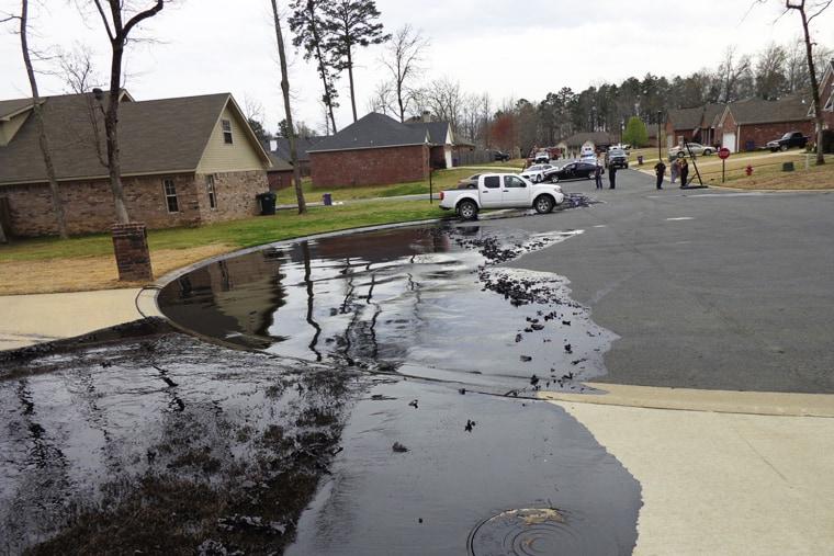 Spilt oil from Exxon pipeline run through North Woods Subdivision in Mayflower, Arkansas, March 29, 2013.