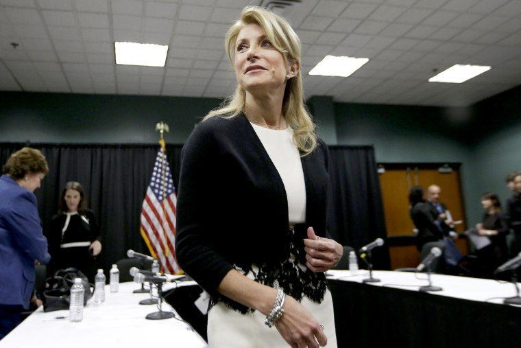 Wendy Davis speaks to reporters after an education roundtable meeting in Arlington, Texas, Jan. 9, 2014.