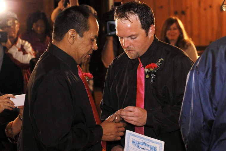 Darren Black Bear and Jason Pickel exchange rings they are married in El Reno, Oklahoma, Oct, 31, 2013.