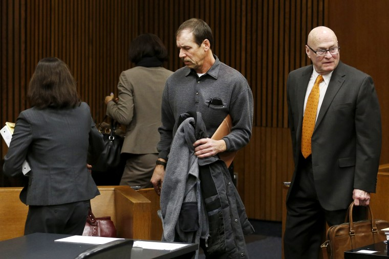 Theodore Wafer and his attorneys leave the courtroom after his arraignment in Detroit, Jan. 15, 2014.