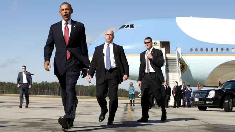 U.S. President Barack Obama walks from Air Force One upon his arrival in Raleigh-Durham, North Carolina Jan. 15, 2014.