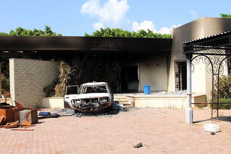 A burnt house and a car are seen inside the US Embassy compound in Benghazi following an overnight attack on the building, Sept. 12, 2012.