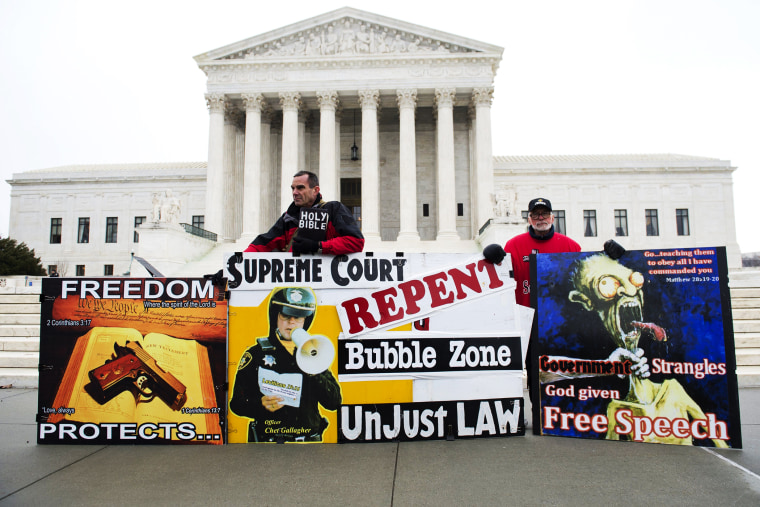 Pro-life demonstrators stand outside the US Supreme Court following oral arguments in the case of McCullen v. Coakley, Jan. 15, 2014.