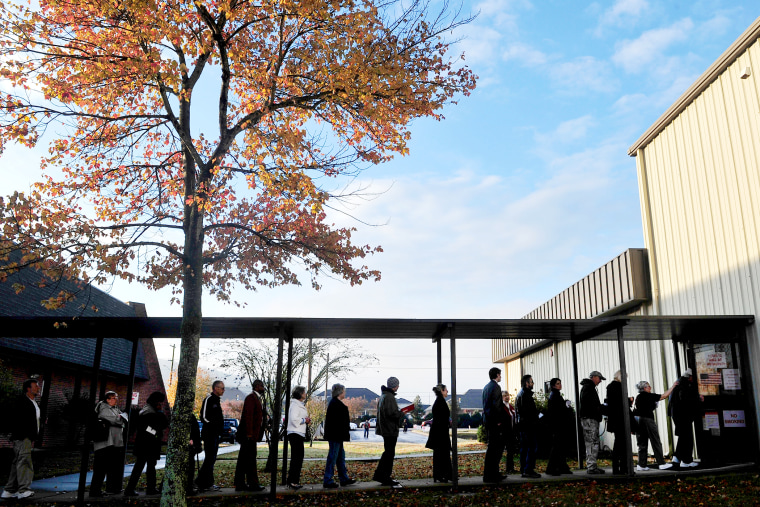 Voters line up and wait for the doors to open at Dwelling Place Church in Huntsvilla, Ala., Nov. 6, 2012.