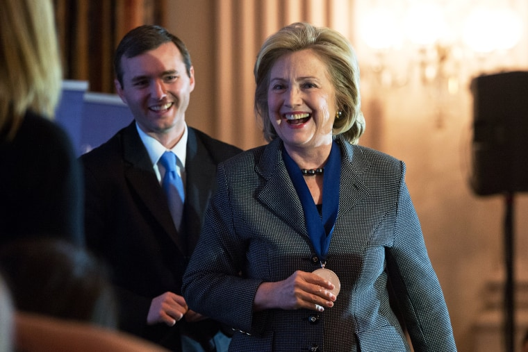 Hillary Clinton smiles after receiving the 2013 Lantos Human Rights Prize, Dec. 6, 2013.