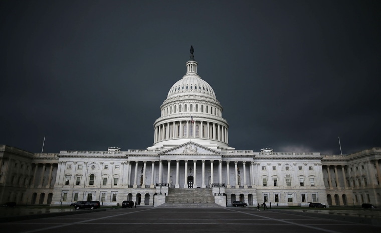 Storm clouds fill the sky over the U.S. Capitol Building, June 13, 2013 in Washington, D.C.