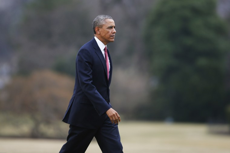 President Barack Obama walks on the South Lawn of the White House in Washington, Jan. 15, 2014.