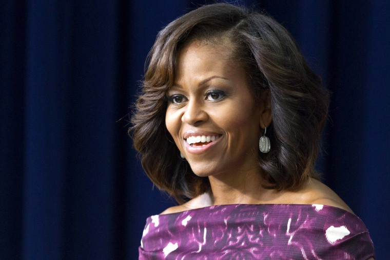 First lady Michelle Obama speaks during an event, July 10, 2013, in Washington.