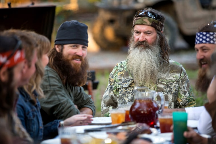 "In an image released by A&E, Phil Robertson is flanked by his sons Jase Robertson, left, and Willie Robertson from the popular series ""Duck Dynasty."""