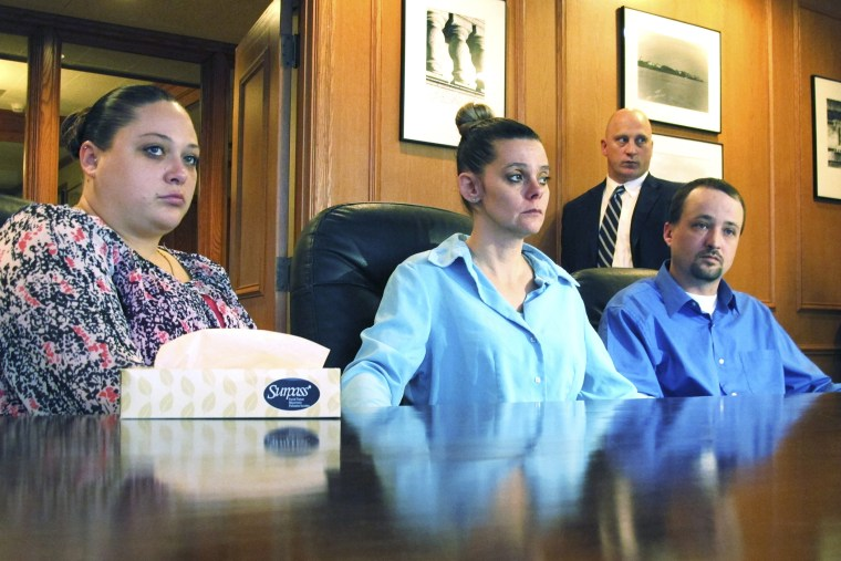 Amber, Dennis, and his wife Missie McGuire, announce their planned lawsuit against the state over the unusually slow execution of their father, Dennis McGuire, Jan. 17, 2014.