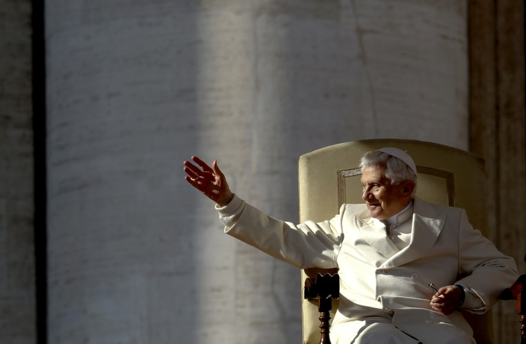 Pope Benedict XVI waves as he leads his weekly audience in Saint Peter's Square at the Vatican Nov. 16, 2011.