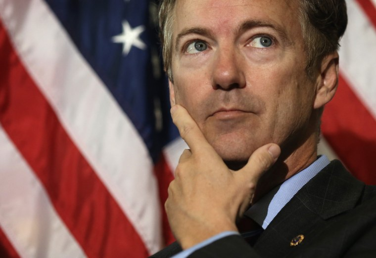 Sen. Rand Paul (R-KY) listens during a news conference on military sexual assault November 6, 2013 on Capitol Hill in Washington, DC.