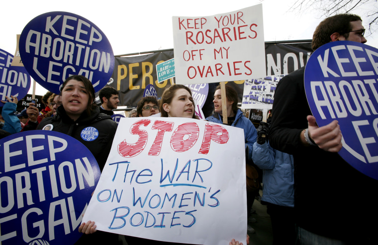 Pro-choice activists demonstrate during March for Life Fund's 37th annual march in Washington