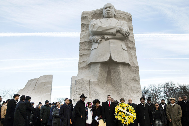 Vincent Gray, mayor of Washington, DC, takes part in a wreath laying ceremony at the Martin Luther King Memorial in Washington, Jan. 20, 2014.