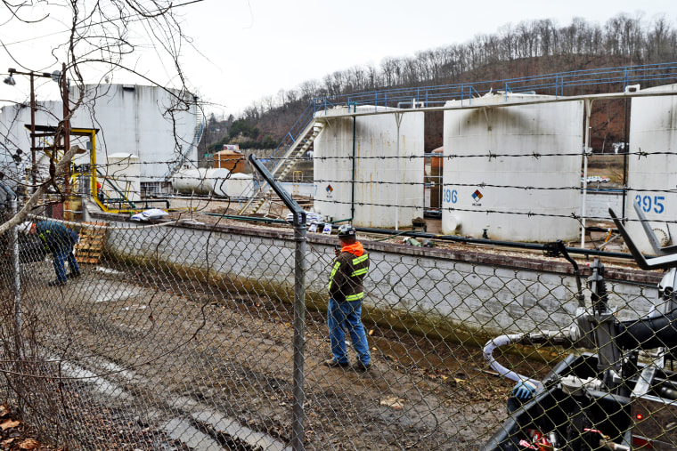 Leaking MCHN tanks at Freedom Industries are being off loaded into tanker trucks in Charleston, West Virginia, Jan. 10, 2014.