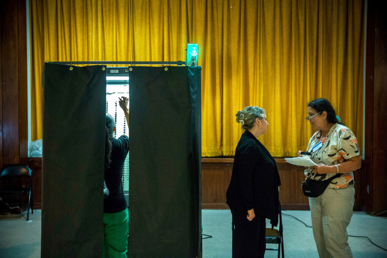 A woman votes at a polling station in New York City, Sept. 10, 2013.