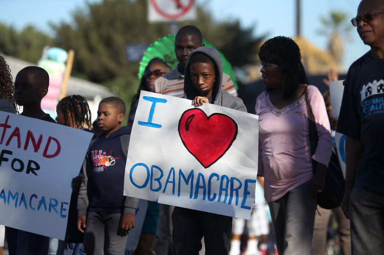 Supporters of the Affordable Care Act march in the 29th annual Kingdom Day Parade on January 20, 2014 in Los Angeles, California.