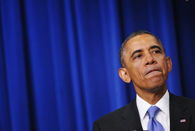 Obama pauses as he speaks during an event on expanding college opportunity, Jan. 16, 2014.