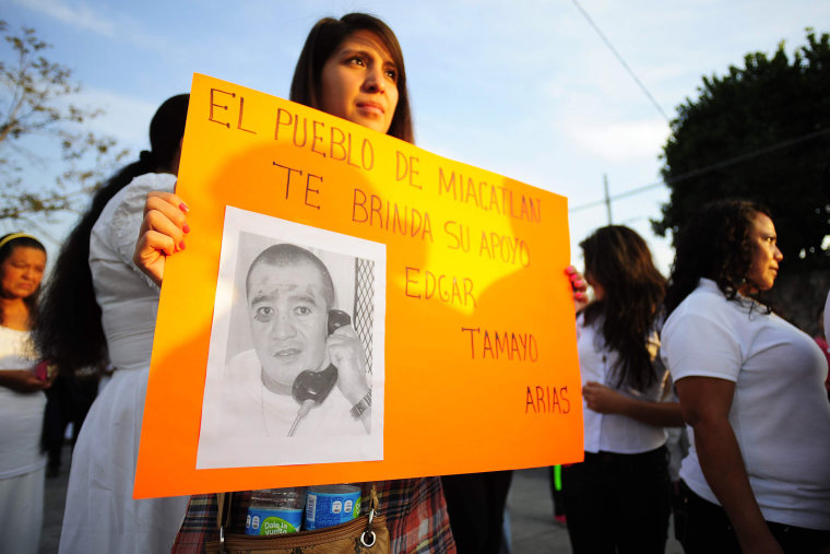 "A woman holds up a sign that reads ""The town of Miacatlan offers you our support, Edgar Tamayo Arias"" during a protest demanding Tamayo's pardon, Jan. 19, 2014."