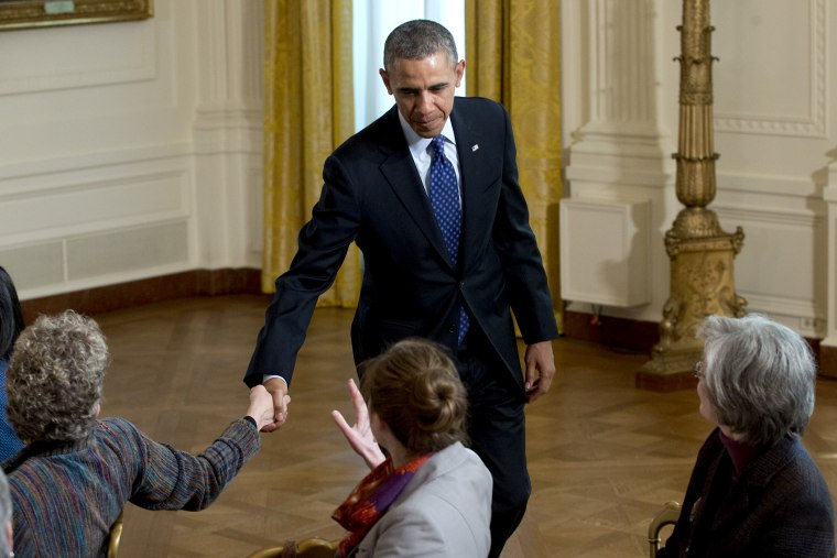 President Barack Obama shakes hands as he leaves the East Room of the White House in Washington, Jan. 22, 2014.