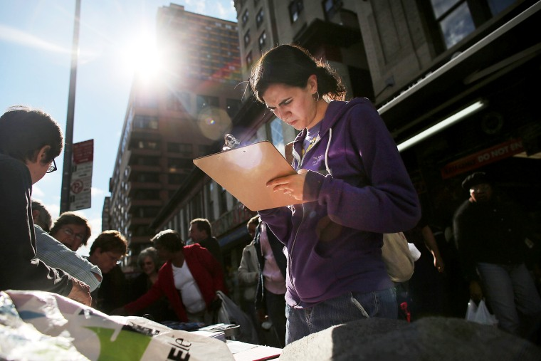 Menucha Goldstein registers to vote in New York, Oct. 10, 2012.