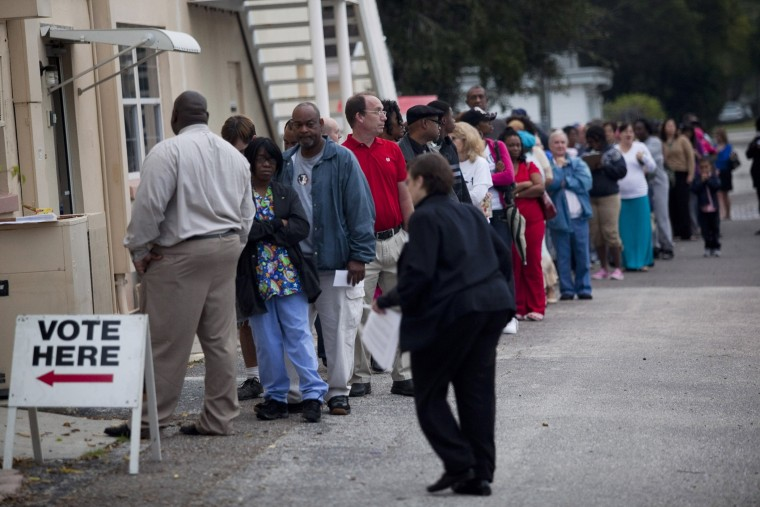 Lines of voters wait to cast their ballots as the polls open on November 6, 2012 in St. Petersburg, Florida.