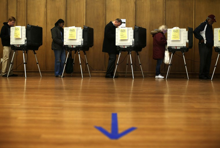 Voters cast their ballots as they participate in early voting, Nov. 2, 2012 in Silver Spring, Maryland.